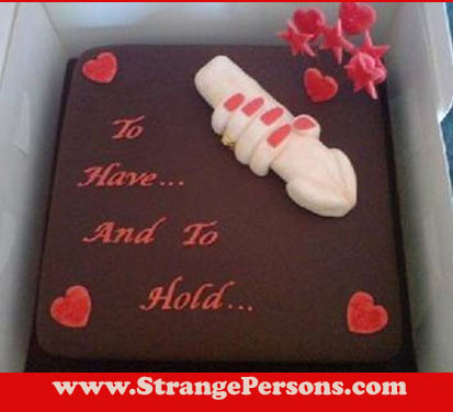wedding cake with a hand holding a penis